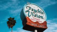 Road sign saying Psychic Vision